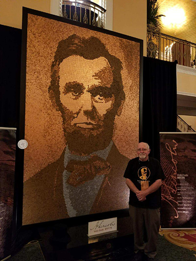 Richard Schlatter stands next to his mammoth Lincoln portrait