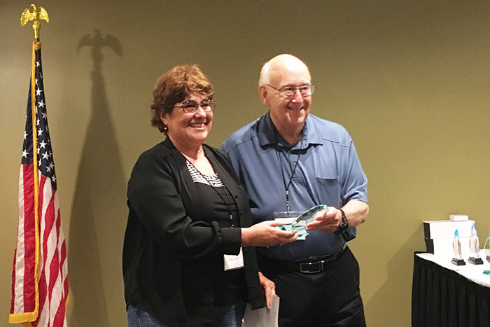 Eve Barber receiving a class award for her exhibit from Gary Dobbins. Photo courtesy Jack Domurat and GHCC