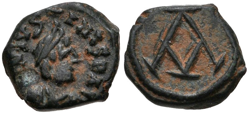 Ancient Byzantine bronze coins, Nummus of Justin I (518-527 CE). Images courtesy CNG, NGC