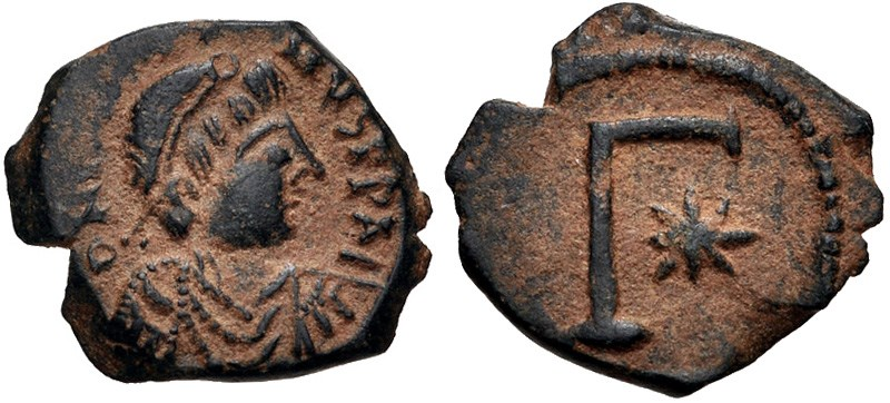 Ancient Byzantine bronze coins, 3-nummi for Justin I at Thessalonica. Images courtesy CNG, NGC