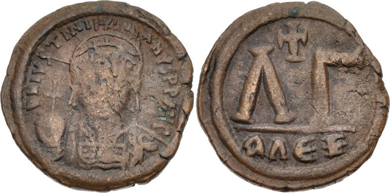 Ancient Byzantine bronze coins, 33-nummi under Justinian I (527-565 CE). Images courtesy CNG, NGC