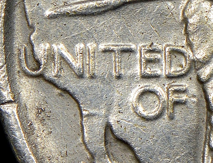 Close up, Counterfeit 1926 Oregon Trail commemorative half dollar. Image courtesy NGC