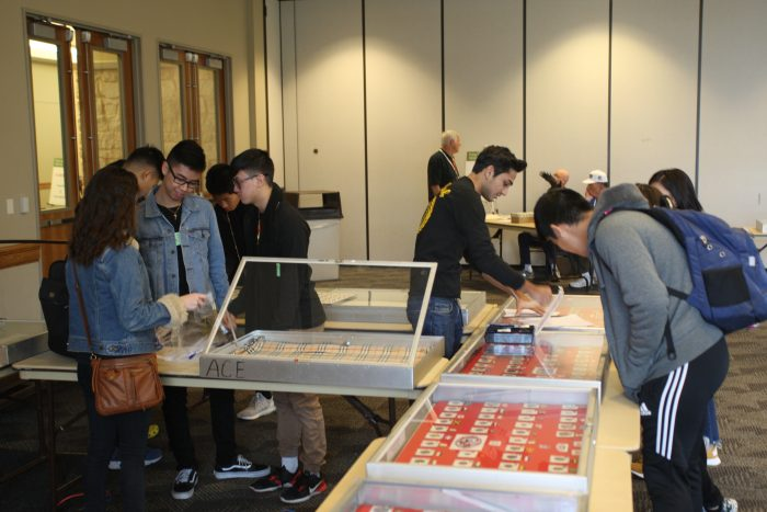 High school students setting up their exhibits