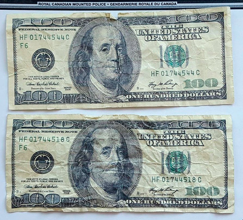 Fake U.S. $100 Federal Reserve Notes found circulating in the Yukon. Image: Royal Canadian Mounted Police