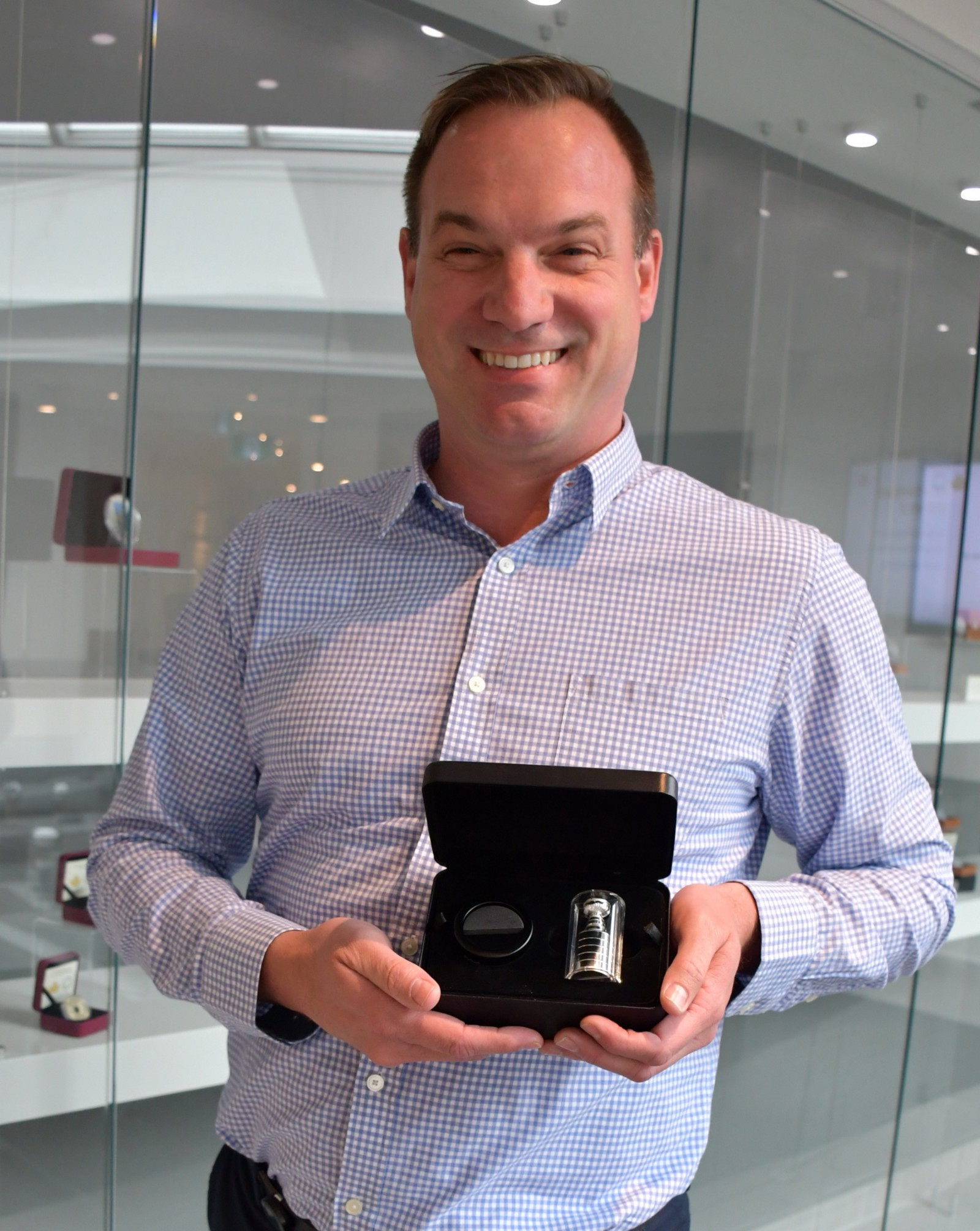 Michael Groves, director of development and applied technology of the Royal Canadian Mint, holds the 2018 Stanley Cup curved coin
