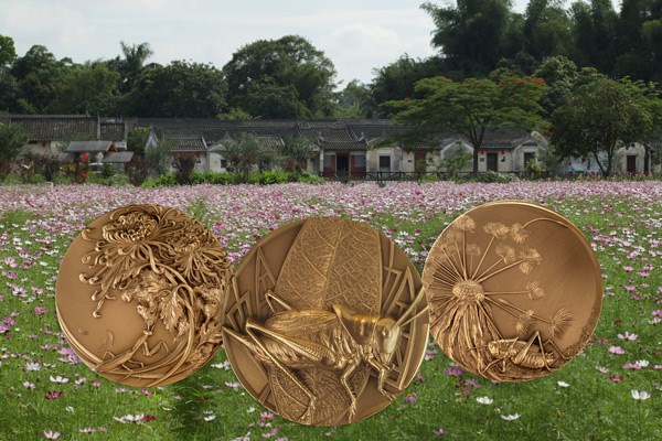 "Three medals from the ""Garden of Life"" series designed by artist Han Xiao Sheng. Image courtesy NGC"