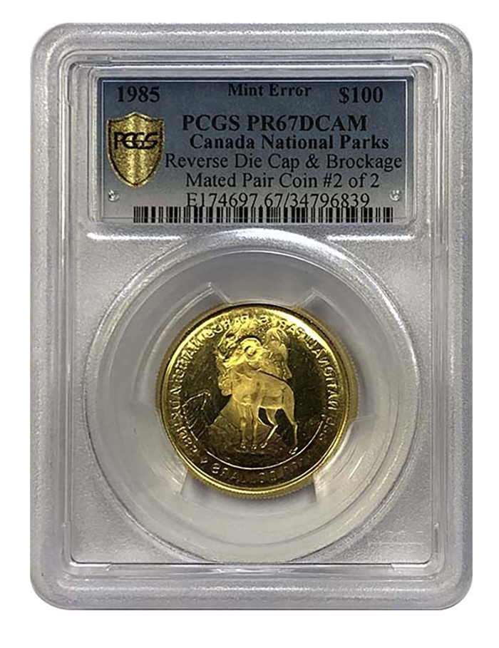 This proof gold reverse die cap (Coin #2) features a mutilated image that juxtaposes obverse and reverse designs.