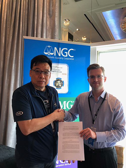 David Chio, President of the Macau Numismatic Society, shakes hands with Max Spiegel, Senior Vice President, Sales & Marketing for NGC, NCS and PMG, after finalizing their cooperation.