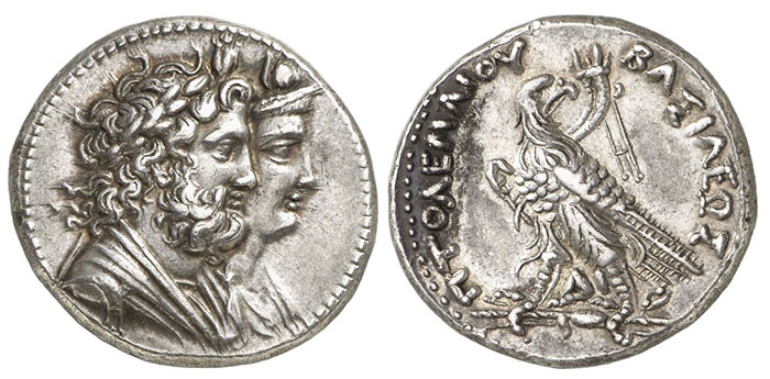Ptolemy IV Philopator. Silver Tetradrachm (14.27 g), Alexandria, ca. 217-215/0 BC. Jugate draped busts of Serapis and Isis right. rev. BAΣIΛEΩΣ ΠTOΛEMAIOY, eagle standing left, head right, on thunderbolt; over shoulder, filleted cornucopiae; between legs, ΔI. Svoronos 1124; SNG Copenhagen 197-8.