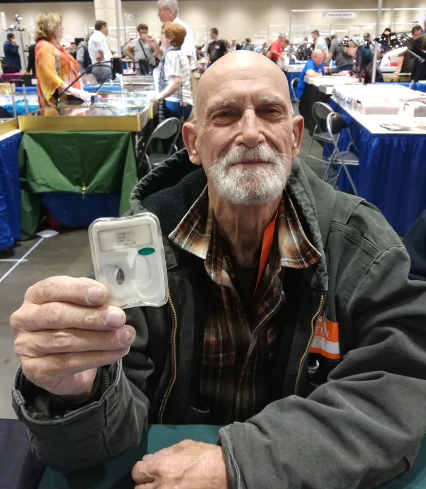 Paradise, California collector Joe Best, showing one of his NGC-certified coins damaged in the 2018 Camp Fire. Photo courtesy NGC