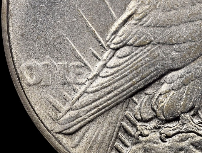 Counterfeit 1928 with reverse of 1921 Peace Dollar. Image courtesy NGC