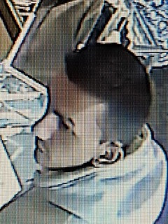 Tacoma coin robbery suspect - NCIC