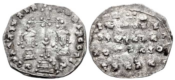 Kievan Rus. Tmutarakan (Principality). temp. Mstislav Volodimirovich Khrobry (the Brave). Circa 990-1024. AR 'Miliaresion' (22mm, 1.63 g, 12h). Imitating a Constantinople mint Miliresion of Basil II Bulgaroktonos. Crowned busts facing, wearing loros and chlamys, respectively; crowns with pendilia; between, long cross crosslet set on base with three steps; pellet-in-crescent on shaft / Pseudo-legend in five lines; ornament above. Golenko 1;. VF, toned, typical irregular flan.