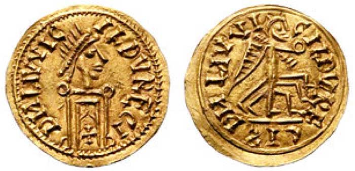 Leovigild AV Tremissis. AD 569-586. DN IIVVIC - ILDVRECI CES (Retrograde) in ex. Heavily stylized, Diademed, Draped and cuirassed bust imitating Justinian I. right / Heavily stylized Victory (With 6 Legs) holding globe, advancing right. 1.30g, 17mm, 7h. Apparently the 2nd and finest example known.