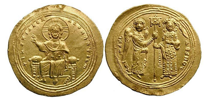 Michael V Kalaphates, AV histamenon nomisma (4.44 gm). Thessalonica 1041-1042. +IhS XIS REX REgNANTIhM, Christ enthroned facing, nimbus cross behind head, holding book of gospels and raising right hand / +MI-XAHL DESPOT, the archangel Michael, winged, on left in tunic and mantle, and Michael V, with short beard, wearing saccos and loros, standing facing, holding labarum between them; manus Dei (the hand of God) crowning him. SB 1826.