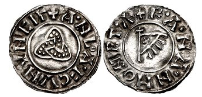 """Anglo-Viking (Hiberno-Norse Northumbria). Anlaf Sithtricsson (Cuaran). First reign, 941-944/5. AR Penny (19mm, 0.98 g, 9h). Triquetra type. York mint; """"Ranan"""", moneyer. + ·A·NL·A·F CVNVNCIΓ, triquetra / + R·A·N·A·N MONET·Λ, fringed triangular standard bearing 'X' on cross-tipped pole. CTCE Group V (unlisted moneyer); SCBI -; BMC –; North 540; SCBC 1020 (this coin illustrated). Near EF. Extremely rare"""