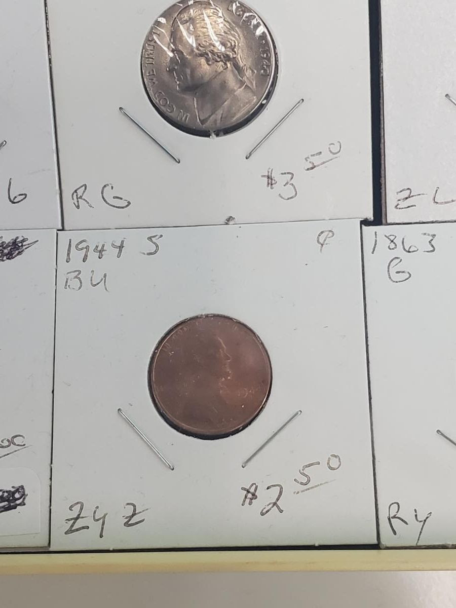 Coin theft in Benbrook Texas - example stolen 2x2s. Courtesy Numismatic Crime Information Center (NCIC), Doug Davis